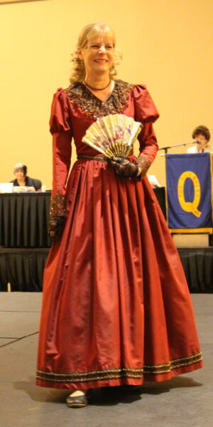 Liz McDonald wearing a baroque costume