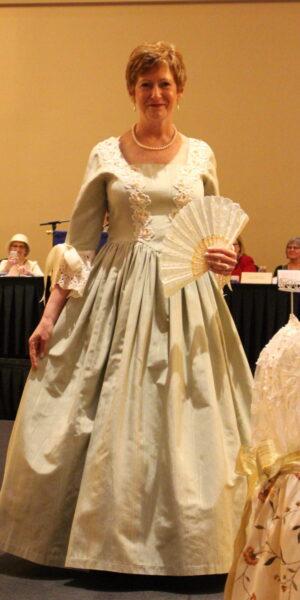 JoAnne Williams wearing an 18th century dress